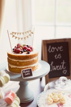 Naked cake. Bunting cake topper. Topped with fresh berries. Highland wedding. Glentruim Castle.