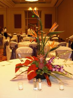 Tropical centerpiece with Birds of Paradise, Antherium, Pineapples, and Orchids. Floral designs by China Rose Florist, Marco Island, Fl.