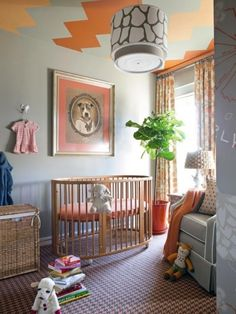 This amazing, funky nursery features a huge framed vintage print above the crib. The rest of the mis-matched details are pulled together with colour. What a fun, modern interior space for a new baby!
