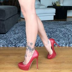 Lucyheels: red pumps, arches, cleavage, great legs, and nice tat