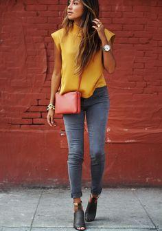 Shop this look on Lookastic:  http://lookastic.com/women/looks/sleeveless-top-skinny-jeans-heeled-sandals-crossbody-bag-watch-bracelet/11164  — Mustard Sleeveless Top  — Silver Watch  — Red Leather Crossbody Bag  — Gold Bracelet  — Grey Skinny Jeans  — Black Leather Heeled Sandals