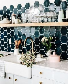 This hexagon back splash is just so so amazing! The deep blue hue, the way it fades out halfway up the wall, that natural-finish shelf- it's all so pretty.