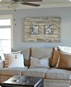 Cadenhead this is almost exactly my new couch WITH pallet art behind it! Wood Pallet Wall Art - Sofa-sized Photo Frame (in this case of family photos) using wood pallet planks. Pallet Frames, Pallet Wall Art, Diy Wall Art, Wood Wall, Pallet Projects, Home Projects, Diy Pallet, Pallet Ideas, Palette Deco