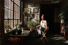 I love this wall of windows, all the plants, and the artwork on the wall. SO lovely. (Interview with New York Times Writer Jenna Wortham)