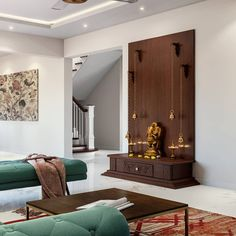 A space to sit back, close your eyes and forget all the chaos for a while. We love this beautiful Pooja space that also doubles as a decorative display unit. Temple Room, Home Temple, Temple Design For Home, Mandir Design, Pooja Room Door Design, Indian Living Rooms, Puja Room, Indian Home Decor, Room Interior