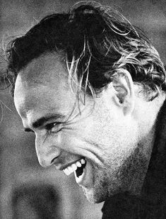 Marlon Brando during a hearty laugh in 1959