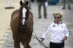 USA's Karen O'Connor runs with her horse Mr Medicott during horse inspection for the equestrian eventing competition at Greenwich Park July 27.