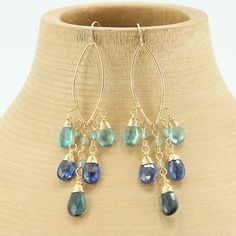 Gold Earrings, Gemstone Earrings, Chandelier Earrings, Marquise Earrings, Hoop Earrings, Blue Topaz Earrings, Dangle Earrings  Sparkly faceted apatite, kyanite, and london blue topaz briolettes with gold filled wire caps hang from a gold filled marquise hoop. These eye catching statement earrings are great to dress up casual outfits or for an elegant ensemble!  - Earrings are a little bit over 2 3/4 measuring from top of earring wire (part that goes into the ear) to bottom of last tear d...