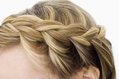 Every time you bring the strand closest to the back of your head over the middle strand, grab a slice of loose hair from the panel and combine this with the strand.