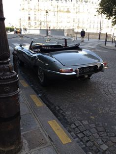 XKE ....Parked..... but always ready to prowl the streets as the sun goes down....Jaguar!