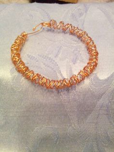 Coiled copper and silver bracelet