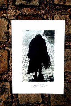 WEARING a Lancashire shawl and clogs an elderly lady walks the cobbles of a Salford street. The photograph, taken by artist Harold Riley in Pendleton in 1960, captures a bygone era.