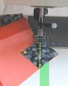 TRIANGLE CORNERS WITHOUT DRAWING A LINE OR CREASING. Place a piece of tape on the bed of the machine so that its edge is in line with the needle. Position the piece with the top corner of the square in front of the needle and start stitching. While stitching, guide the other corner along edge of masking tape. Do not look at the needle. In this way you stitch exactly on the diagonal line without marking the diagonal. Geta's Quilting Studio.