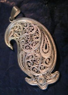 Beautiful Persian Silver jewelry pendant / Malileh kari: is one of the original persian handicraft , branch of the metal art that done with thin silver filaments.