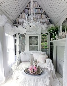 other side of shabby chic loft for mini-guest house. It's a little too ruffly for me, but, i like the idea of how the space is used