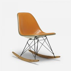 Charles and Ray Eames RKR  Herman Miller  USA, 1950  leather, molded fiberglass, birch, enameled steel, rubber