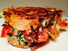 "Here at CheeseRank, we keep a sharp eye out for people with a flair for making insanely delicious grilled cheese sandwiches. Our friend Katie over at Le Petit Artichaut created one she calls the ""GetInMyBelly,"" and was kind enough to allow us to share it on CheeseRank. Katie's description of the sandwich..."