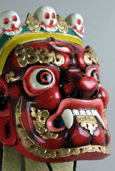 Presentationl red Mahakala mask from Bhutan