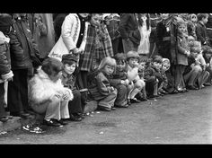 #Ireland #PaddyDay #ItalishMagazine collection St Patrick's Day Parade. Dublin City. March 17th 1975. The camera caught the attention of these youngsters during a lull in the proceedings at the GPO.