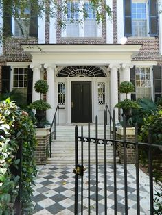 I love the look of this Charleston home- black door with sunburst window design above and the classic columns. Plus the checkered pattern on the exterior stones! Home Design, Patio Design, Exterior Design, Interior And Exterior, Exterior Paint, Casa Loft, Villa, Front Entrances, Home Upgrades