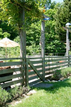 I like the idea of having a few taller poles to have wire run across for flowers, beans, etc.