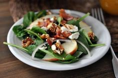 This really is the best spinach salad ever! Loaded with sweet + spicy nuts, apples, feta, and bacon, it is amazingly delicious.