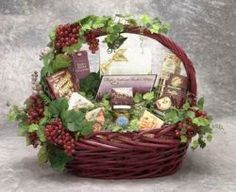Gourmet Gala Gift Basket.  Chardonnay wine truffles, creamy camembert cheese spread, vineyard focaccia crackers, chocolate cream filled pastry cookies, smoked salmon pate, black olives and more.