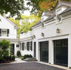 Black garage doors stand out against the white siding and tie in with the black shutters on the house. Style At Home, Style Blog, Exterior Design, Interior And Exterior, Garage Exterior, 3 Car Garage, Exterior Remodel, Dream Garage, Black Garage Doors
