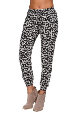 """TheChallis Jogger Pants feature a tribal print throughout and drawstring waistband. We love wearing these slouchy pants with our cropped tops and sandals or heels! Unlined.%09High rise%0911"""" rise%0928"""" inseam%09Measured from a size small%09Model is wearing a small%09Her measurements: Height: 5'9"""" Bust: 34"""" Waist: 25"""" Hips: 36""""%09100% rayon%09Machine washable"""