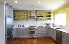 Bright color behind open shelves. Anyone can do this — just remove the doors from your upper cabinets and paint the backs a bright hue. Match the wall color, as shown here, for a seamless look.
