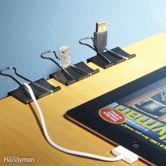 binder clip = cable catcher: clips keep cord ends from dropping off your deck top...