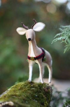 Felt reindeer (I made this for P. last Christmas! From handmade tea-stained, spice-scented felt, adding eyes, eyelashes, spots, and a red nose)