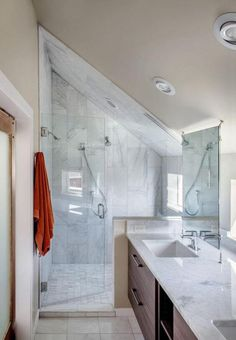 Sloped ceilings can always prove challenging, but bathrooms seem to heighten the design dilemma. Where can fixtures be placed to maximum advantage...