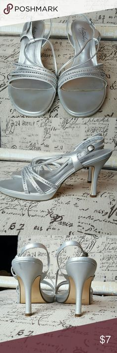 Silver Heels Silver Heels that are in okay condition, just trying to get rid of them! Signs of wear: bottoms, one of the soles. Great for a school dance or wedding!   **Feel free to ask any q's or make an offer! **10% off bundles of 2+ items Shoes Heels