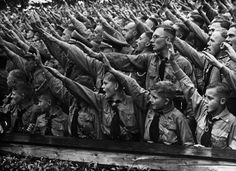 Hitler Youth members saluting at a rally. Details unknown