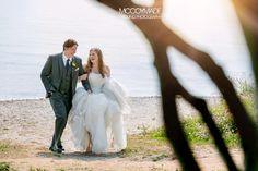 A bride & groom walk along the shoreline of Mackinac Island in Northern Michigan on their wedding day! image by McCoy Made, 2014  #MackinacIslandWedding #PureMichigan #NorthernMichiganWedding #McCoyMadePhotography #BeachWedding
