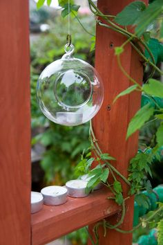 Tea light and small details can bring a garden to life #tealight #woodenscreen #candles #garden #gardenlighting