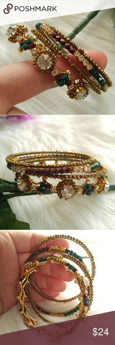 Beautiful bangle bracelet set gold tone gems Set of 4 bangle bracelets - gold tone metal wrapped with sparkly clear gems and ruby red and emerald green color beads- fits very small wrist best - in great shape- from a smoke free home :) Jewelry Bracelets