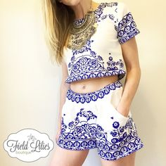"""Two Piece Porcelain Print Set Trendy white and blue porcelain print set. Short sleeve crop top and matching shorts with elastic waist, pockets and soft pleats. Polyester material. Size small.  Measurements: Shoulder (13.4"""") Bust (33.9"""") Top Length (15.7"""") Waist (23.6""""-28.3"""") Shorts Length (11.4"""") Care instructions: Hand wash cold, lay flat to dry. Price is firm unless bundled. Tops Crop Tops"""