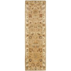 Enhance your living space with this handmade taupe wool rug. A French-inspired design and floral motifs give this hand-tufted rug a unique look. With a 0.5-inch pile height and durable cotton canvas backing, this traditional rug will handle heavy use.