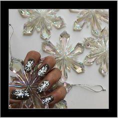 DIY fun snowflake nail art design