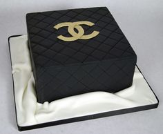D7004 Simple gold and black chanel cake Created by: www.fortheloveofcake.ca With locations in Toronto and Oakville