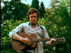 The Great, Johnny Cash, playing a Martin 0-17