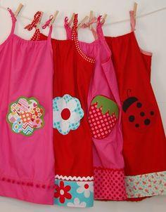 Pillowcase dress with embellished pockets  http://lotsofpinkhere.blogspot.com/2011/03/dress-girl-around-world-shaped-pocket.html