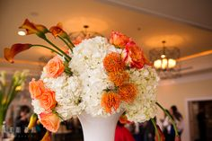 Orange calla lily and rose with white hydrangea table centerpiece by Intrige Design and Decor. Chesapeake Bay Beach Club wedding bridal testing photos by photographers of Leo Dj Photography. http://leodjphoto.com