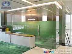 Office door and partitions for NBAD branches in Abu Dhabi made by Sahara Glass, complemented with ROYAL° handles and accessories.