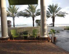 Relax and watch the world go by in these chairs out front here at The Inn at Key West! www.theinnatkeywest.com