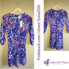"""Romper Jumpsuits YUMI KIM Printed V Neck Jumper Size XS.  New With Tags $228.00  Crossover v neck romper with 3/4 tabbed sleeves. Shorts are lined.  100% Polyester.  Measurements (garment flat) : Length: 30"""" Underarm to Underarm: 16"""" Belted Waist: 14"""" Inseam: 3.5""""  Availability:  Blue: XS, S, M. Pink: XS, L.    ❗️ Please - no trades, PP, holds, or Modeling.   ✔️ Reasonable offers considered when submitted using the blue """"offer"""" button.    Bundle 2+ items for a 20% discount!    Stop by my…"""