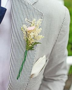 """See the """"Boutonniere"""" in our A Whimsical Beach Destination Wedding in New York gallery"""