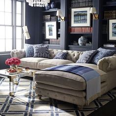 Such a relaxing place to read a good book. This home study is so calming with it's dark blues & neutral tones